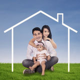 Happy family and dream home Royalty Free Stock Image