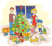 Happy family dressing up the christmas tree Royalty Free Stock Photo