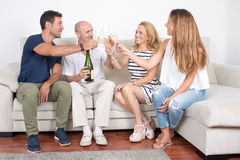 Happy family drinking champagne. Family with elderly children celebrating with champagne Stock Images