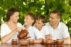 Happy family drinking tea Stock Photography