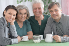 Happy family drinking tea Royalty Free Stock Images