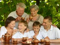 Happy family drinking tea Stock Images