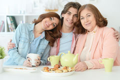 Happy family drinking tea together Stock Images