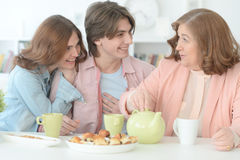 Happy family drinking tea together Stock Photos