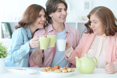 Happy family drinking tea together Royalty Free Stock Images