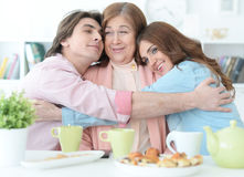 Happy family drinking tea together Stock Photo