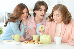 Happy family drinking tea together Stock Photography