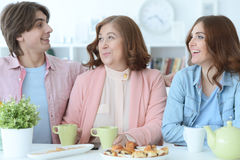 Happy family drinking tea together Stock Image
