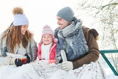 Happy family drinking tea during winter trip. In the nature royalty free stock photos