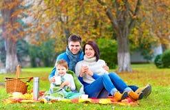 Happy family drinking warm tea on autumn picnic Royalty Free Stock Image