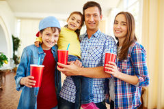Happy family with drinks Stock Images