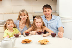 Happy family drinks tea Royalty Free Stock Images