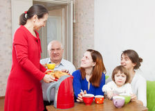 Happy   family drinks tea and eats cakes Stock Photo