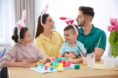 Happy family with Easter eggs at home. royalty free stock images