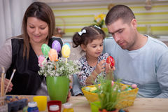 Happy family in easter time. Easter eggs painted by the family royalty free stock image