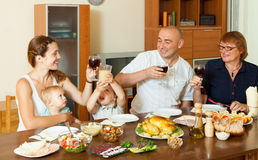 Happy family eating chicken Stock Photos