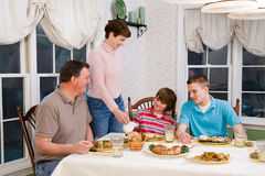 Happy family eating at dinner table Royalty Free Stock Photography