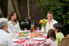 Happy family eating in the garden Stock Photo
