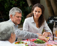 Happy family eating in the garden Stock Images