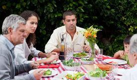 Happy family eating in the garden Stock Photos