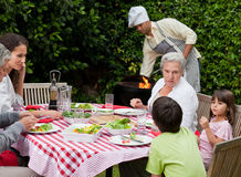Happy family eating in the garden Royalty Free Stock Photography
