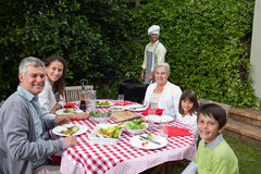 Happy family eating in the garden Royalty Free Stock Image