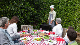 Happy family eating in the garden Stock Image