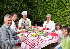 Happy family eating in the garden Royalty Free Stock Photos