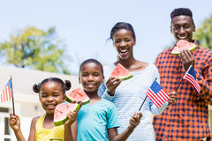 Happy family eating watermelon and showing usa flag Stock Images