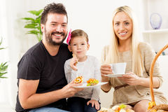 Happy Family Eats Pastry For Breakfast Royalty Free Stock Images