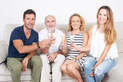 Happy family with elderly children. Family with elderly children celebrating with champagne Stock Photo