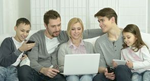 Happy family with electronic gadgets Royalty Free Stock Photography