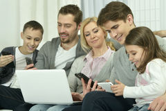 Happy family with electronic gadgets Stock Photo