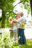 Happy family embracing in garden Stock Photography