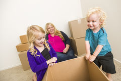 Happy Family In Empty Room Playing With Moving Boxes Stock Photo