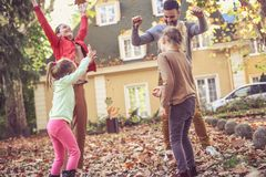 Happy family enjoy in autumn season at front of their backyard. Young family Stock Images
