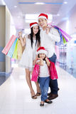 Happy family enjoy christmas sale Royalty Free Stock Photo