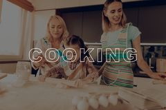 Happy Family Enjoy Cooking. Girl Hold Rolling Pin. Girl Knead Dough. Grandmother Help Girl. Happy Family Cooking. Little Girl Prepare Dough. Child Make Cookies royalty free stock images