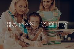 Happy Family Enjoy Cooking. Girl Knead Dough. Woman Search Recipes. Grandmother Help Girl. Happy Family Cooking. Little Girl Prepare Dough. Child Make Cookies royalty free stock images
