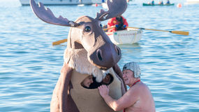 Happy family enjoy New year polar bear swim. The happy family enjoy their new year winter Polar bear swimming .English bay .Vancouver.Canada Stock Photo