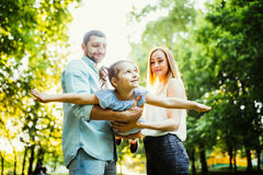 Happy family enjoy summer in green summer park. Happy family enjoy summer in summer park Stock Images