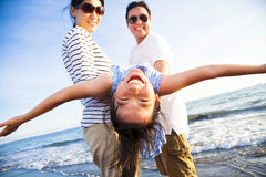 Happy family enjoy summer vacation on the beach. Happy asian family enjoy summer vacation on the beach Stock Image