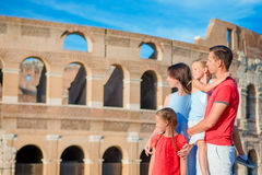 Happy family enjoy their vacation on Colosseum background. Italian european vacation together in Rome Royalty Free Stock Photo