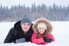 Happy family enjoy winter snowy day Royalty Free Stock Photo