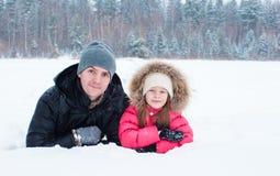 Happy family enjoy winter snowy day Stock Photo