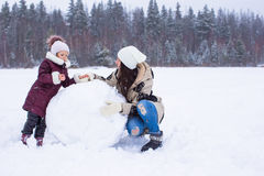 Happy family enjoy winter snowy day Royalty Free Stock Images