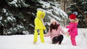 Happy family enjoy winter snowy day stock video footage