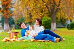Happy family enjoying autumn picnic Stock Images