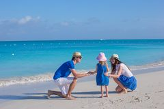 Happy family enjoying beach vacation Stock Photography