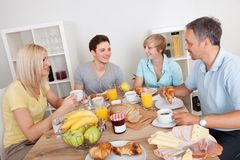 Happy family enjoying breakfast Royalty Free Stock Images